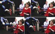 Woman controls robotic arm using mind-control circuitry