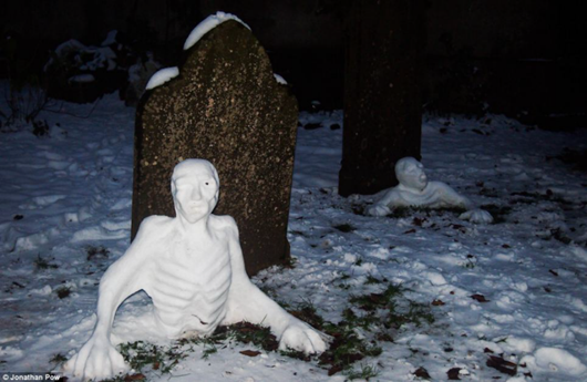 Awesome Zombie snowmen crawling out of the ground in Bristol