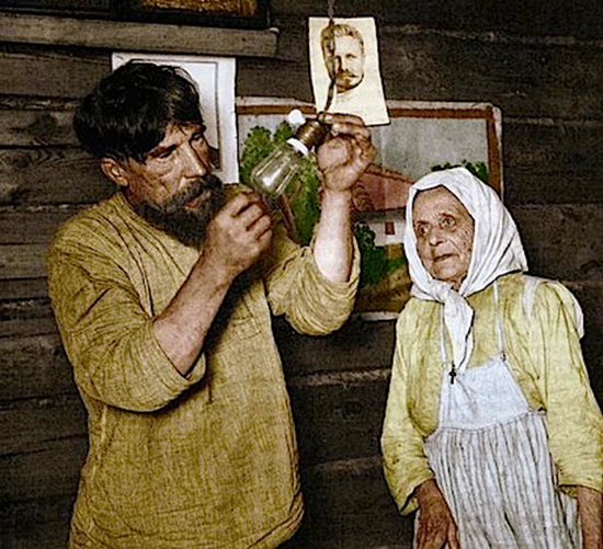Russian peasants receive electricity in home in 1920