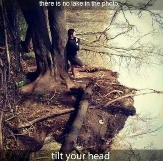 Man standing by a lake is an optical illusion