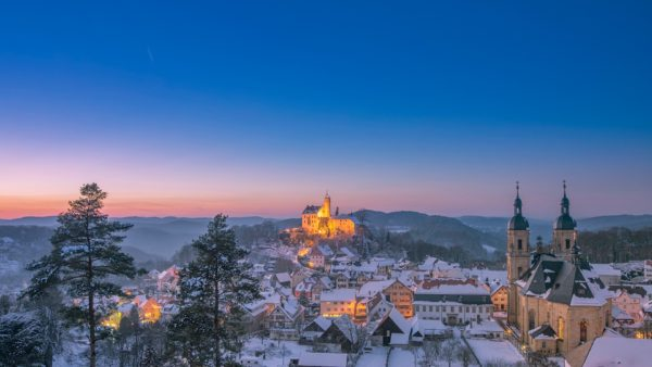 village of gößweinstein gössweinstein in winter at dusk franconian switzerland germany